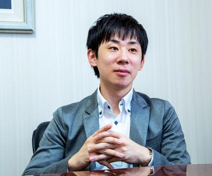 富田 賢史